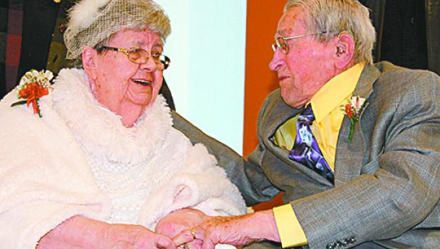 Longtime sweethearts Don and Gloria Norton, Staples, renewed their vows on their 70th wedding anniversary Feb. 14, at Lakewood Health System Care Center, where they now reside. The couple shared a kiss and a smile after exchanging rings and a heartfelt promise to love each other 'for better or worse, for richer or poorer, in sickness and in health.' (Staples World photos by Dawn Timbs)