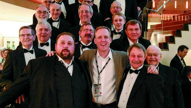 A contingent of men from the Staples Area Men's Chorus had the opportunity to sing at Carnegie Hall in New York City in a combined chorus under the direction of Lee Nelson, front center. Rob Freelove, SAMC director, is on the left and Kevin Olsen, SAMC president-elect, is on the right. Behind them are most of the SAMC members who made the trip. (Submitted photo)