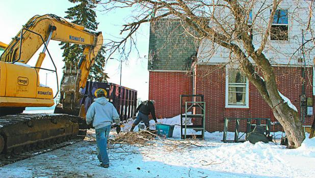 Todd Jenkins and Dave Owens, employees with Hengel Ready Mix and Construction of Pillager, worked Jan. 16, hauling out debris from a house along Hwy 10 in Staples, prior to its upcoming demolition.