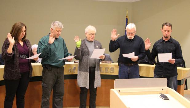 Five newly elected members of the Staples City Council took the oath of office as they began their new terms on the council. From left, Rachel Johnson, Chris Etzler, Mary Theurer, Doug Case and Brian Fisher. Johnson and Fisher are starting their first term on the council, while Etzler was re-elected as mayor and Theurer and Case were re-elected as council members. (Staples World photo by Mark Anderson)