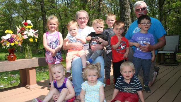 After 37 years of caring for children at Kids Kountry Kastle in rural Staples, daycare provider Deb Hausmann has officially retired. Her last day of operation was May 31. She is pictured with her final group of 'kids' as well as her husband, Dale, who often helped out at their home daycare. Front row, from left: Kaitlyn Savaloja, Lettie Anderson, Tristin Thorne. Back: Alexis Savaloja, Noah Funk, Deb Hausmann, Wyatt Pogreba, Connor Reeck, Caleb Vangsness, Dale Hausmann, Jackson Vangsness. Two bouquets of flo