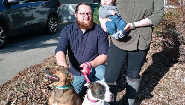 After straying away from her home on 4th St. NE in Staples March 27, Patches (the white dog) was reunited with her family four days later. Patches is pictured with her dog pal Teddy; and human family Brandon, Leah and baby Baylor Christensen. (Staples World photo by Dawn Timbs)