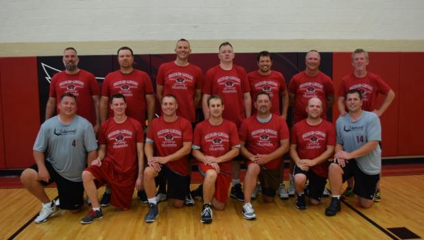 """The """"1996 Ghosts of the Past,"""" comprised with players from the '80s and '90s, won the mens division of the Staples Alumni Basketball Tournament in an overtime thriller against the """"Class of 2003 Slightly Below Average"""" team. Front row from left, Trevor Peterson, Erik Kelly, Daryn Lecy, Jeff Joerger, Ryan Beachy, Cy Bestland and Blaine Joerger; back row, Loren Brownell, Dan Otteson, Derek Hasselberg, Chris Heier, Jamie Nichols, John Riewer and Kevin Coughlin. (Submitted photo)"""