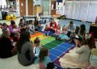 Kaycia Ellingsen (far right) leads Circle Time at a recent ECFE (Early Childhood Family Education) class in Staples. During this time children and their parents/caregivers sing songs, hear a story and even 'make rain,' as they are pictured doing above. The family classes are held on Fridays from 9 - 10:30 p.m., at the Staples Family Center. A family infant class is offered on Fridays from 11 a.m. - noon at the Staples Community Center. (Staples World photo by Dawn Timbs)