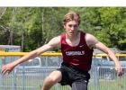 Max Giza, top, looks to the next hurdle while placing 2nd in the 300 meter hurdles.